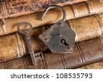 Open Padlock And Rusty Key...