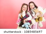 little girl with toy. two... | Shutterstock . vector #1085485697