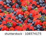 mixed berries in a pile - stock photo
