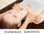 Beautiful young caucasian woman undergoing a massage - stock photo