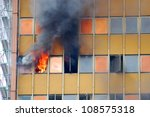 old skyscraper in fire - stock photo