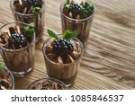 chocolate mousse in glasses ... | Shutterstock . vector #1085846537