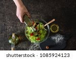 woman pouring olive oil into... | Shutterstock . vector #1085924123