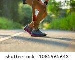 woman runner got sports injury... | Shutterstock . vector #1085965643