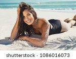 happy young woman lying on... | Shutterstock . vector #1086016073