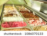 ice cream fridge with creamy... | Shutterstock . vector #1086070133