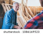 carpenters at work ... | Shutterstock . vector #1086169523