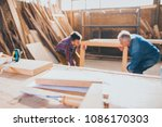 carpenters holding constructed... | Shutterstock . vector #1086170303
