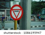 Small photo of Scene from Cuba with close up of full stop sign