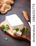 feta cheese on rusty background.... | Shutterstock . vector #1086231773