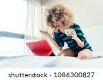 woman student on her bed... | Shutterstock . vector #1086300827