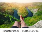 Small photo of Person sitting on a peak and relaxing. Nature of Czech Republic and sightseeing called Vyhlídka Máj. Vltava river.