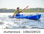 young professional kayaker...   Shutterstock . vector #1086328523
