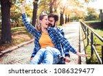 young couple enjoying in a bike ... | Shutterstock . vector #1086329477