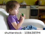Little caucasian child using inhaler - stock photo