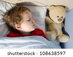 Little boy sleeping in his bed - stock photo