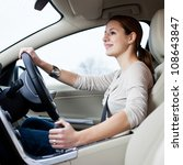 pretty young woman driving her... | Shutterstock . vector #108643847