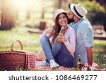 happy young couple enjoying... | Shutterstock . vector #1086469277