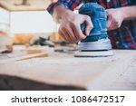 close up of carpenter at work... | Shutterstock . vector #1086472517