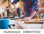 carpenter at work using  hand... | Shutterstock . vector #1086472523