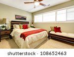 Bedroom interior with red and green, elegant simple design. - stock photo