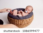 mom puts the child in the basket | Shutterstock . vector #1086599477