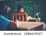 girl with crayon drawing at... | Shutterstock . vector #1086619427