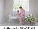 pregnant women with little girl ... | Shutterstock . vector #1086635543