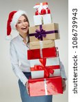 businesswoman wearing santa hat ... | Shutterstock . vector #1086739943
