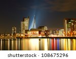 skyline of the south bank of rotterdam by night - stock photo