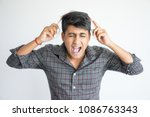 excited young indian man...   Shutterstock . vector #1086763343