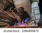 industrial worker is welding...   Shutterstock . vector #1086800873