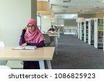 a beautiful muslimah student... | Shutterstock . vector #1086825923