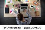 unhappy designer counting money ... | Shutterstock . vector #1086909503
