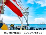 Small photo of Fee fall type life boat at afterward/stern on cargo vessel . for save life of people.