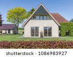 dutch detached house | Shutterstock . vector #1086983927