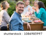 looking at the camera  a man in ... | Shutterstock . vector #1086985997