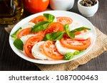 close up photo of caprese salad ... | Shutterstock . vector #1087000463
