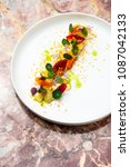 Small photo of Fine dining, Elegant fish tartare with asparagus and spices