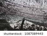 Small photo of Close up black shading net pattern texture and background.Weaved plastic shade/ covers plants and materials to protect and avoid direct sunlight that could harm the object underneat.