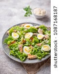 caesar salad with quail eggs ... | Shutterstock . vector #1087168187