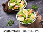 caesar salad with quail eggs ... | Shutterstock . vector #1087168193