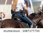german police horsewoman rides... | Shutterstock . vector #1087177733