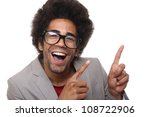Nerdy man with a funny face is pointing - stock photo