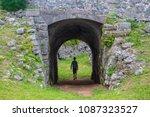 Small photo of Boy walking through tunnel - Fort Scaur, Bermuda