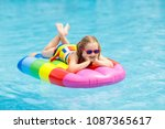 happy child on inflatable ice... | Shutterstock . vector #1087365617