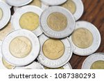 canadian two dollar coins... | Shutterstock . vector #1087380293