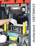 operator stamping metal sheet... | Shutterstock . vector #1087388423