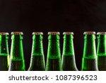 alcohol. green glass bottles of ... | Shutterstock . vector #1087396523