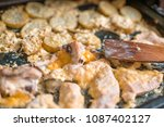 fried chicken and potatoes | Shutterstock . vector #1087402127